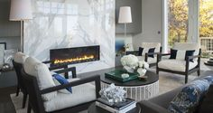 A marble fireplaces makes for a stunning centerpiece.