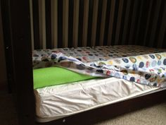 Used a pool noodle as a guard rail for boys toddler bed. Got the idea from googling guard rails for toddler bed...so not my genius idea.  Works well and kept boys from rolling out. And did not have to buy the extra part for the beds.