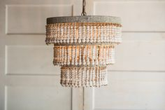 """Three tiered chandelier strung with natural colored wooden beads. (Pairs beautifully with our Edison bulbs!) 20.5"""" w x 20"""" h"""