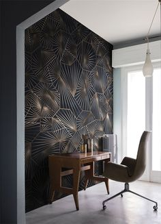The irregular shape of the furniture and the pattern on the wall are very art deco