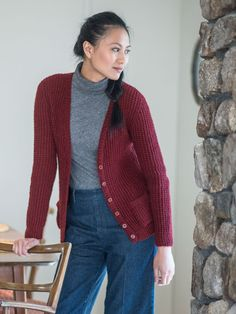This slim-fitting cardigan from designer Noriko Ho is a perfect wardrobe staple. Knit from the top down, both the body and sleeves feature a simple textured stitch pattern. Pockets are added before finishing.