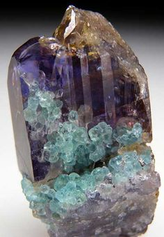 Unique crystal of small green Apatite (analyses indicated Fluorapatite) on two faces of a complete, well terminated Tanzanite crystal. I have seen Tanzanite spcimens with Apatite on the Graphite matrix, but never one with Apatite on the Tanzanite crystal.