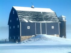 Irish Barn, Traverse City, MI.  1920's Gambrel Barn restored and painted blue.  Wooden Silo.