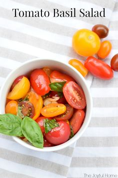 My Tomato Basil Salad is full of delicious summer flavors. Fresh tomatoes and basil combine with garlic infused oil and tangy vinegar to make the perfect summer salad.