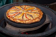 Pizza on the Big Green Egg is amazing.<<Wait...Pizza? On the Egg? We've gotta try this!