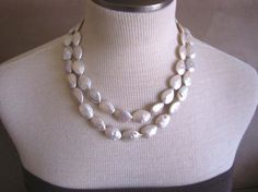 """Bold oval and teardrop-shaped Freshwater pearls hang from a sterling silver end piece and toggle clasp.     The pearls measure approximately 13x18mm and are ivory in color with a nice reflective pearl sheen.    The pearls have some small, natural inclusions and shapes.    The necklace hangs 19"""" to 21""""."""