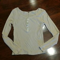 FREE PEOPLE Long sleeve top Cream colored with snap buttons Size medium  This is a shorter crop top long sleeve and sits just above a mid rise pair of pants/jeans In excellent preowned condition No issues of any kind.   Bundle to get 20% off automatically Free People Tops Tees - Long Sleeve