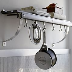 Wall pot rack, maybe for side of cabinet or wall in dinning room..crate & Barrel $129.00