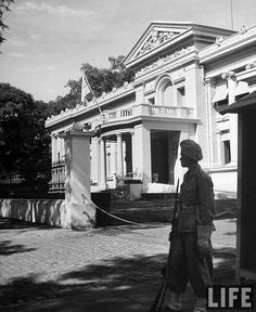 Saigon 1948 - Vietnamese military soldier standing guard, in French Indo China.