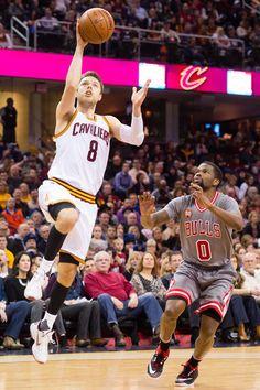 26529c600 Matthew Dellavedova Photos - Matthew Dellavedova  8 of the Cleveland  Cavaliers shoots over Aaron Brooks