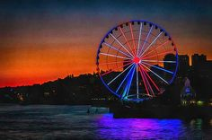 """What Goes Up"" by CarolLMiller Photography – Beautiful artwork of Seattle's Great Wheel at sunset.  Artwork available as: canvas print, acrylic print, metal print, framed print, poster, greeting card, and phone case.  You can also buy the print on high quality acid-free paper and frame to your own specifications.  All products include a money-back guarantee."