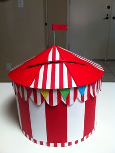 Handmade by DawnMarie of TriggerHappyChicks.com.  Hat box into a carnival tent for wedding cards using craft store paper.