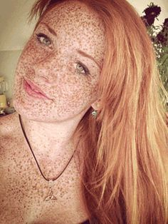 Freckled redhead teen with very