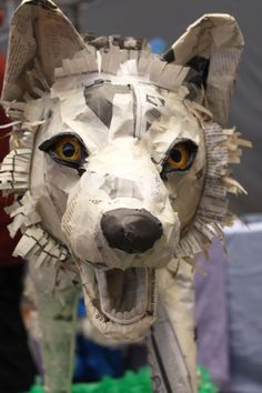 Trash art wolf.It is very nice to make animals with only news paper. I want to try something like that .