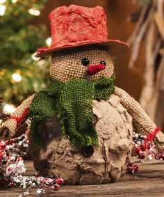 Place this snowman around the house or by the tree for a touch of adorable holiday magic. Crafted with spirited charm and darling details, it's a delightful addition to festive décor.