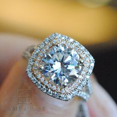 Precision Set 18K white and rose gold cushion double halo ring from James Free Jewelers.