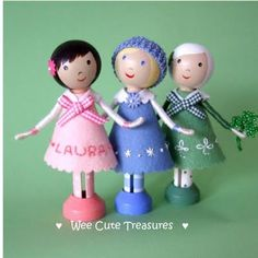 Clothespin dolls in little felt dresses.