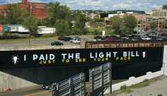 """""""I paid the light bill just to see your face."""" Mural by Stephen Powers."""