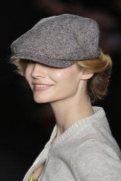 Love the juxtaposition of the soft bun against a boyish cap