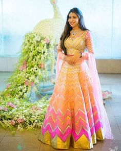 We absolutely love the vibrant look of this lehenga and it's interesting pattern! Ideal for a Sangeet attire for the bride!