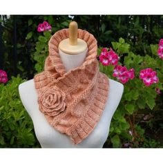 """This scarf is knitted vertically from the center out to the sides from provisionally cast on stitches. The scalloped rose is placed on a pin and used as a closure for the many versatile ways you can """"wrap"""" this scarf. Kit includes Ruffled and Ruched knitting pattern and 2 skeins of Malabrigo Merino Worsted yarn. You will also need size US 9 knitting needles."""
