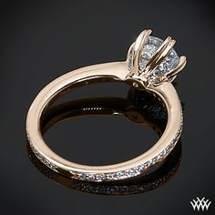 18k Rose Gold Ritani Setting Diamond Engagement Ring from the Ritani Setting Collection. It features a gorgeous 6-prong head that will perfectly compliment the round diamond center of your choice. This design really packs a punch with Round Brilliant Diamond Melee microset within the head and along the shank.