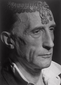 Man Ray, Marcel Duchamp with Turkish Coin Necklace on Forehead, Hollywood, 1949. © Man Ray Trust / Artists Rights Society (ARS), New York / ADAGP, Paris