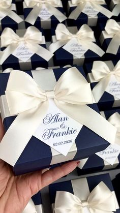 Elegant navy blue wedding favor box with champagne satin ribbon bow and custom names, Elegant personalized gift boxes make a unique way to thank guests for attending your special day. Wedding Favours Navy Blue, Champagne Wedding Favors, Wedding Candy Table, Wedding After Party, Handmade Wedding Favours, Wedding Gift Boxes, Wedding Gifts For Guests, Personalized Wedding Favors, Blue Wedding