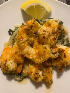 2 pounds raw large shrimp, peeled, deveined (tails on or off) salt and pepper, to taste 1/3 cup melted butter, divided (about 5 tablespoons solid butter) 1/4 cup lemon juice 4 cloves garlic, minced 2 tablespoons chopped fresh parsley 1/3 cup panko bread crumbs 1/3 cup grated parmesan cheese 1/2 teaspoon, or more, to taste fresh chopped parsley, for garnish lemon wedges, to serve Baked Shrimp Scampi, Large Shrimp, Panko Bread Crumbs, Garlic Minced, Garlic Butter, Melted Butter, Salt, Stuffed Peppers, Dishes