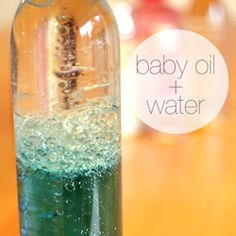 Sensory bottle - baby oil and coloured water