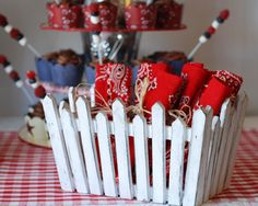 Inspiration: picket fence, add bird house/nest...  Use cupcake stand for centerpiece (auction item)