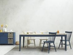 How many bums do you need to park? 8 or This extendable kitchen table does the lot. We love its inky blue legs and vintage-y parquet top.