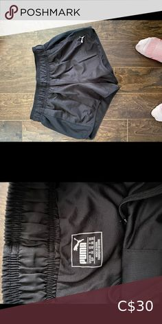 Black puma running shorts Puma running shorts in black. Excellent condition, worn a handful of times. Draw string tie on the inside of the waist band. No pulling or pulling of material. Seems all intact. Comes from a smoke free home. Puma Shorts Athletic Shorts Nike Running Shorts, Sport Shorts, Nike Shorts, Black Puma, Black Nikes, Athletic Skirts, Fleece Shorts