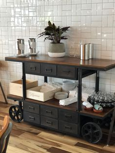 Love our reclaimed wood & Iron bar cart against the white tile backsplash