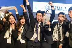 A national team holds their trophy up high at #EnactusWorldCup.