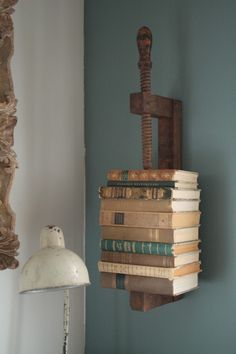 Great idea for a book shelf too...if you add another one on one end and a bit of wood in between!