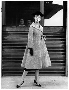 This is an image of an A-line coat by Simonetta Fabiani,  Florence, Italy 1955. Dior first represented the A-line silhouette in his collection of 1955. Balenciaga introduced his unfitted dress style just a year before, however the chemise style dresses didn't take off immediately.