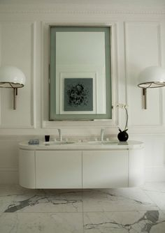 Love these oversize sconces & the floating vanity