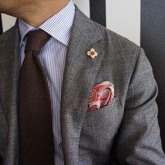 Grey plaid jacket, white shirt with light blue dress stripes, brown tie