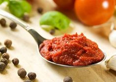 Instead of tomato sauce: I would try homemade roasted red pepper puree. Just roast the red peppers in the oven, skin, puree in a blender, then reduce in a pan on the stove on low for a while. This way the puree will be thick like tomato paste. You can store it in the fridge for a 2-3 weeks or freeze in ice cube tray. I've been using that for soups, sauces and stews lately, just loving it.