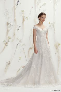 Lillian West Spring 2016 Wedding Dresses | Wedding Inspirasi | Off-The-Shoulder Beaded Lace A-Line Bridal Gown Which Showcases Lace Capped Sleeves, V Neckline, Buttons Down The Back & Court Length Train****
