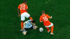 2014 FIFA World Cup™ - Photos - FIFA.com  Lionel Messi of Argentina is challenged by Georginio Wijnaldum and Jordy Clasie of the Netherlands