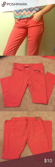 """American Eagle Orange Denim Jeans (OFFERS WELCOME) *  American Eagle Orange Denim Skinny Jeans * Wear with any cute pastel patterned top for an instant hit :) * Full length jeans, skinny fit, front and back pockets are all real, but front are very shallow (only about 2"""" deep) * 98% cotton, 2% spandex * About 16"""" front of waist, 38.5"""" height from top to bottom * Very loved, but no major marks or flaws and still has some life left! ☺️ American Eagle Outfitters Jeans Skinny"""