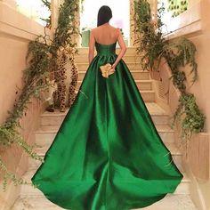 Daring, bold and elegant, this @elizabethkennedynewyork emerald green statement gown has us in Love! #weddedwonderland