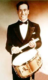 """Billy Gladstone (born William Goldstein, was a drummer, percussionist, drum builder, inventor, and drum teacher.  He was perhaps most famous for his snare drum technique, often referred to as """"The Gladstone Technique"""". This technique involves the use of the fingers to control the rebound of the drum stick.  As a teacher, Gladstone taught, formally or informally, a number of noted jazz drummers, including Joe Morello, Shelly Manne, and Buddy Rich.)"""