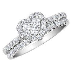 anillo de compromiso con diamante central en talla corazón