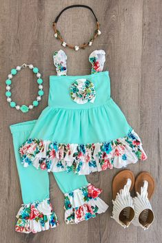 The Serenity Ruffle Capri Set - MINT/WHITE FLORAL These little Capri Sets are so cute and the colors are so trendy! Soft capri bottoms and a matching strap tunic top with a rosette flower in the middle. Cute Little Girls Outfits, Little Girl Dresses, Toddler Outfits, Kids Outfits, Cute Outfits, Baby Girl Fashion, Kids Fashion, Cute Baby Clothes, Baby Dress