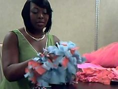 Cheerleading pom poms from plastic tablecloths. Now that is what I'm talking about. Going to do them this way.