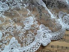 Hey, I found this really awesome Etsy listing at https://www.etsy.com/listing/95259511/off-white-lace-trim-with-roses-organza