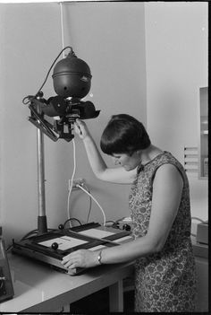 Taking an enlargement from a microfilm. J.S. Battye Library of West Australian History and State Archives, 1969